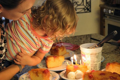 Lilly Bug blows out the candles on her homemade cake.